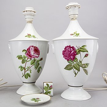 A pair of Porcelaine de Paris table lamps with ashtray and holder for matches France later part of the 20th century.