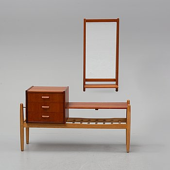 A teak mirror and chest of drawers, second half of the 20th Century.