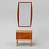 A teak mirror and a chest of drawers, second half of the 20th century.