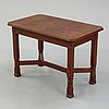 Nordiska kompaniet, an oak art nouveau table, 1916.