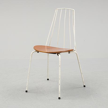 A mid 20th century steel and teak chair.