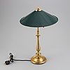 A brass table light, first half of the 20th century.
