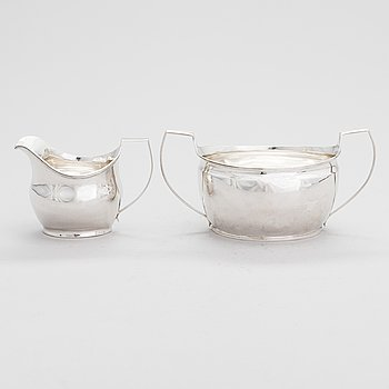 An early 19th-century, sterling silver sugar bowl and a cream jug, London 1808. Sugar bowl, mark of Elizabeth Morley.