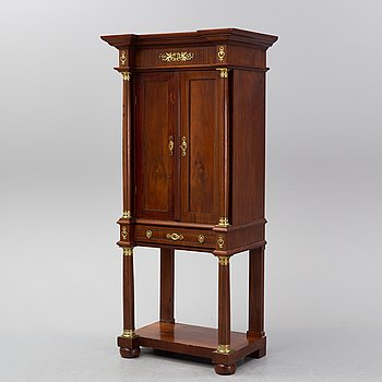A mahogany empire-style cabinet from around 1900.
