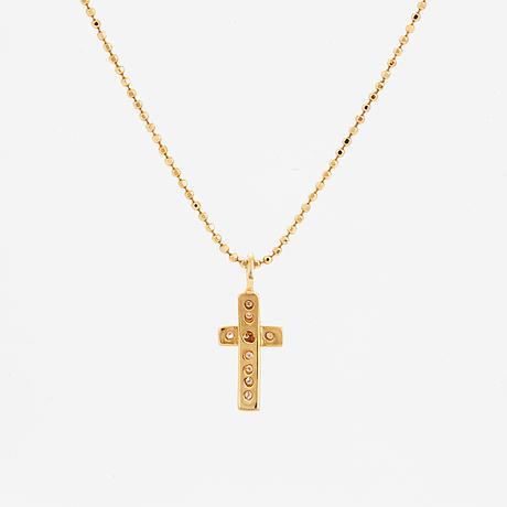 Efva attling, 18k gold and brilliant-cut diamond cross pendant.