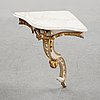 A samll console table for a corner with a wooden top.