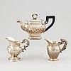 A mixed lot of two 19th century silver and parcel-gilt creamers and a coffee-pot.