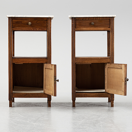 A pair of early 20th century bedside tables.