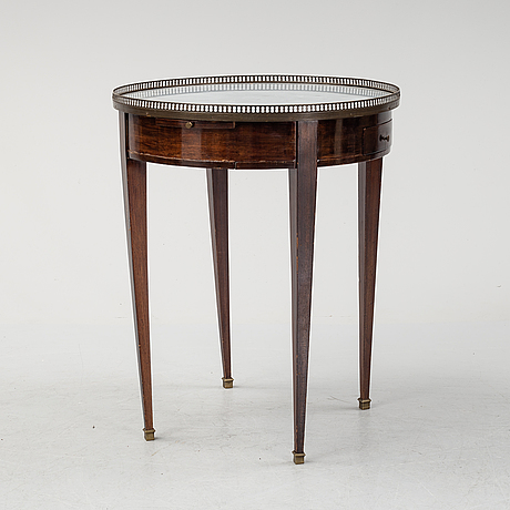 A louis xvi-style table from the first half of the 20th century.
