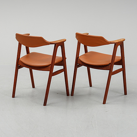 A pair of teak armchairs, 1950's/60's.