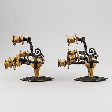 Appliquer, ett par, brons, omkring år 1900.