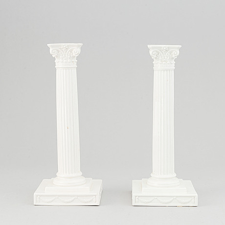 A pair of early 20th century flintware candlesticks from gustavsberg.