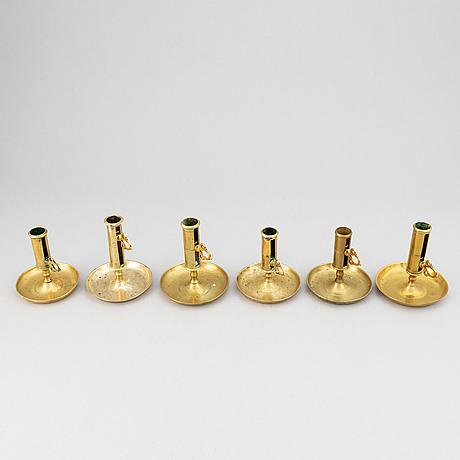 A set of six 19th-century brass candlesticks.