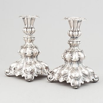 A pair of silver candlesticks.