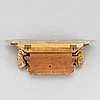 A louis xvi style sculptured, painted and gilded wall bracket,