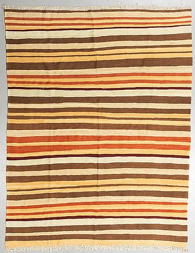 A carpet, flat weave, ca 227 x 175 cm.