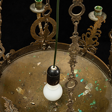 An empire style chandelier from around the year 1900.