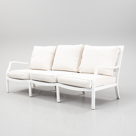 A sofa and two lounge chairs, with a table, gloster.