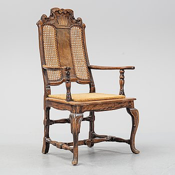 A mid 18th century late baroque armchair.
