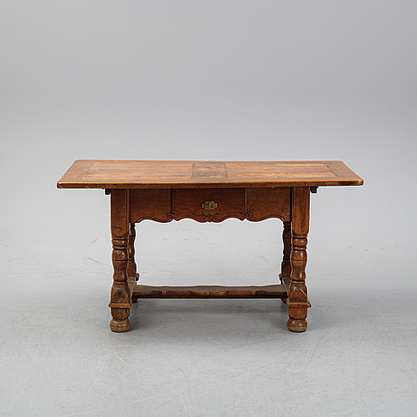 A 19th century baroque style table.
