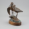 Kent ullberg. a bronze sculpture of two curlews, signed ullberg and numbered 12/50.