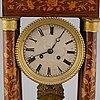 A mahogany inlay mantle clock, 19th century.