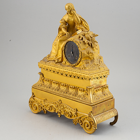 A french gilt bronze mantle clock, mid 19th century.