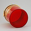 A red glass wine cooler.