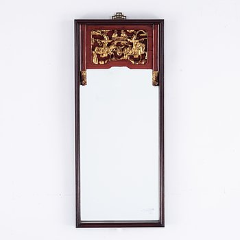 A Chinese lacquered and gilt framed mirror, 20th century.