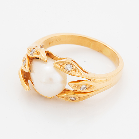 Cultured freshwater pearl and brilliant-cut diamond ring.