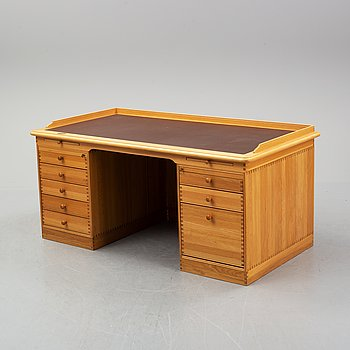 An oak writing desk by Finn N Hansen. End of the 20th Century.