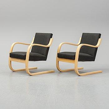 Alvar Aalto, a pair of model 406  birch armchairs, Artek, Finland, 2002.