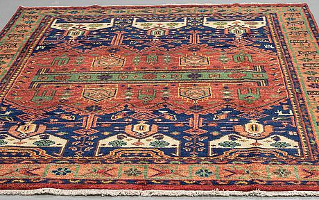 A carpet, hereke design, ca 305 x 242 cm.