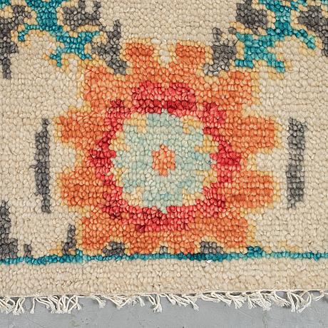 A carpet, uzbek ikat design, ca 365 x 260 cm.
