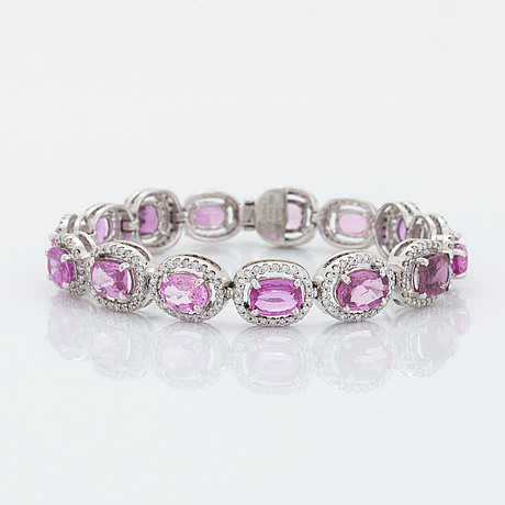 An 18k white gold bracelet set with faceted pink sapphires.