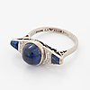 An 18k white gold ring set with synthetic sapphires.
