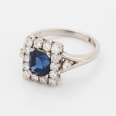 A platinum ring set with a faceted sapphire.