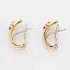 A pair of 18k gold earrings.