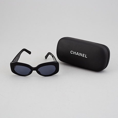 Chanel, a pair of sunglasses.