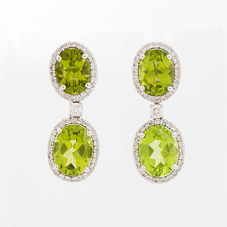 A pair of 18k white gold earrings set with peridots.