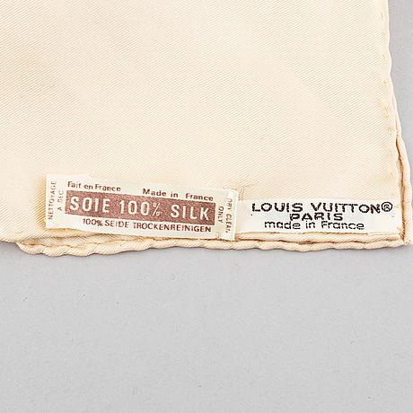 Louis vuitton, a silk scarf.