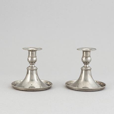 A pair of pewter candlesticks, svesnkt tenn, stockholm, 1929.