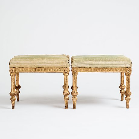 A royal pair of late gustavian stools by,erik öhrmark and pehr ljung after design by louis masreliez, late 18th century.