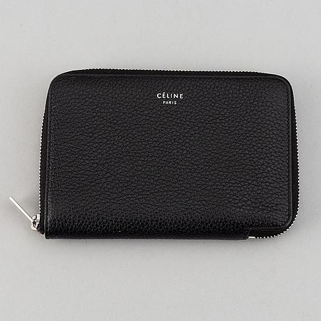 Céline, a leather 'zipped wallet'.