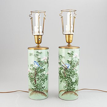 A pair of celadon ground, famille rose hat stands, turned into table lamps, 20th century.