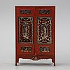 A chinese red lacquered cabinet, first half of the 20th century.