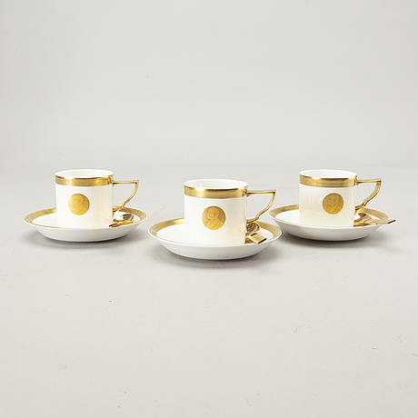Karin björquist, a set of 12 coffee cups and 12 spoons.