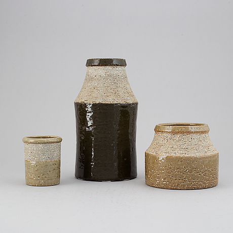 Hertha bengtson, a set of three stoneware vases for rörstrand.