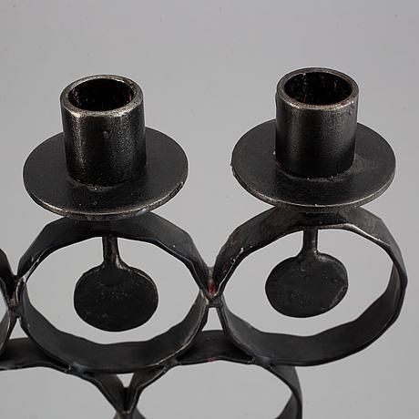 A cast iron candelabra by bertil vallien for kosta smide, sweden.