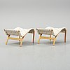 A pair of 'eva' stools by bruno mathsson, dated 2000.